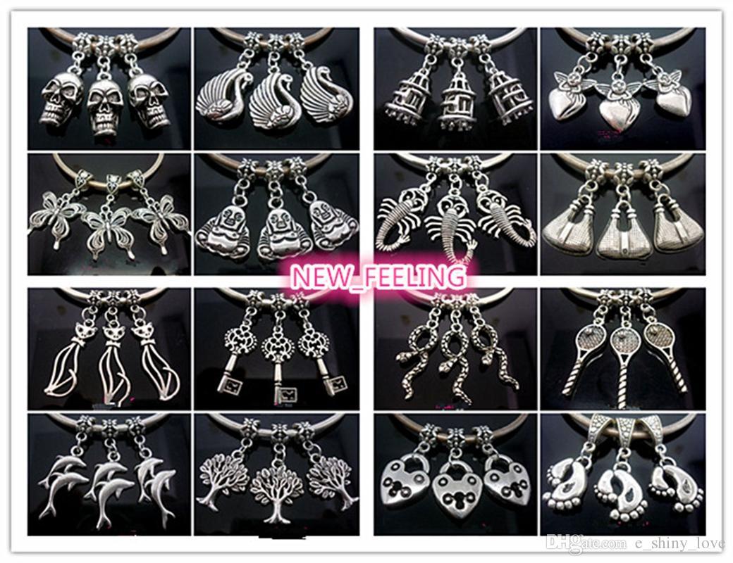 Comercio al por mayor a granel bajo precio 100 unids mezclado encantos de plata tibetana para la joyería que hace encantos sueltos de bricolaje para la pulsera europea