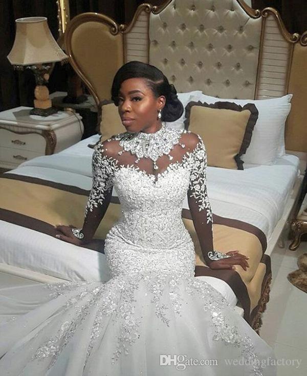 Stunning Luxury Långärmad Hög Neck Bröllopsklänningar Kristaller Beaded Lace Appliques Illusion Back African Bridal Gowns