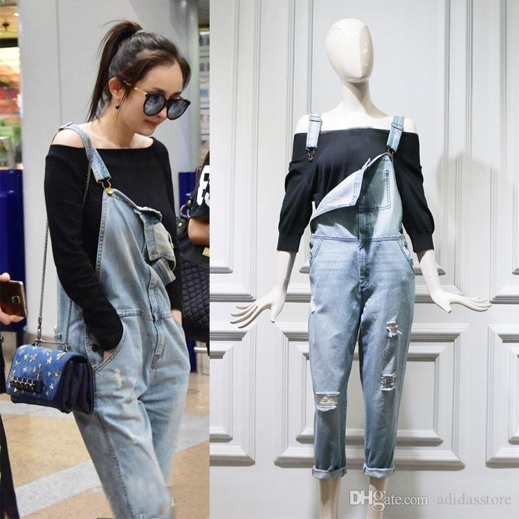 2019 Women Ripped Denim Overalls Loose Fit Light Blue Bib Jeans Fashion  Design Button Embellished Streetwear From Adidasstore 35cb509f19