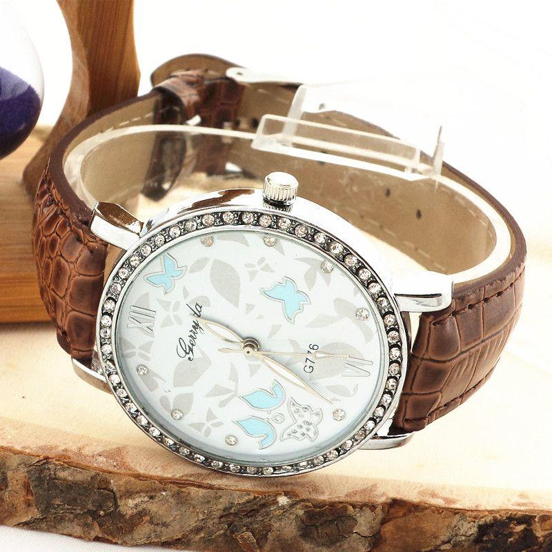 Бесплатная доставка!ПВХ кожаный ремешок,серебряная пластина чехол с горный хрусталь круг,бабочка циферблат,кварцевый механизм,gerryda мода женщина Леди часы