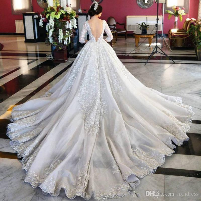 Nueva Arabesco sin respaldo de lujo una línea de medias mangas florales 3D-Apliques sin espalda Vestidos de novia Vestidos de novia con arco de la correa tribunal tren 353