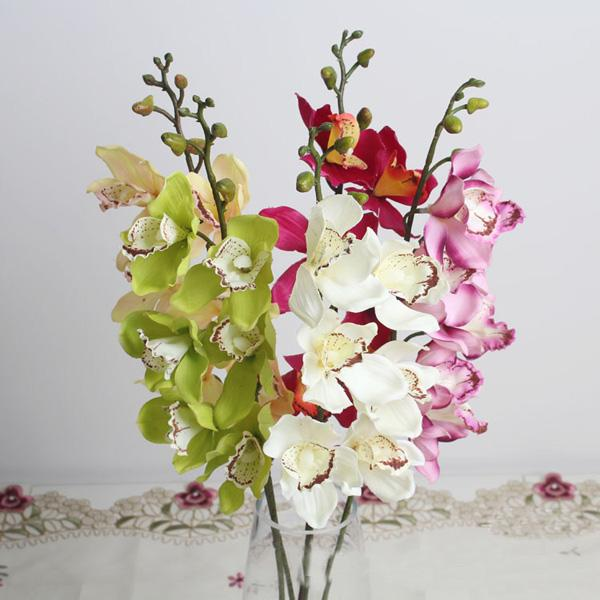 Artificial cymbidium silk wedding flower in white measures 236 artificial cymbidium silk wedding flower in white measures 236 inches tall a lovely wedding or bouque perfect for submersible arrangements real touch mightylinksfo