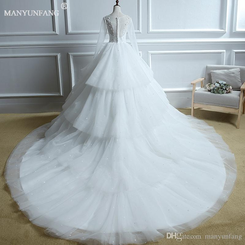 2018 Manyunfang Sheer Long Sleeve Wedding Dresses Scoop Neck Buttons Back Lace Appliques Satin Ball Gown Bridal Gowns Beach Wedding Gowns