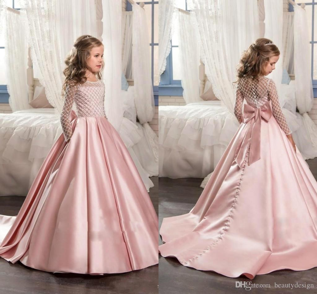 d68b8187074 2018 New Pink Long Sleeves Flower Girls Dresses For Wedding With Bow Knot  Delicate Beaded Sequins Ball Gown Floor Length Girls Formal Wears Girls ...