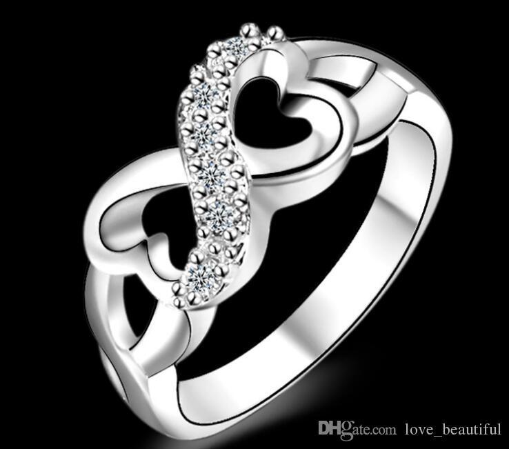 Überzug 925 Sterling Silber 8 Worte Unendlichkeit Ring Charms Mann Frau Kristall Hochzeit Ringe Modeschmuck Größe US6 / 7/8/9/10