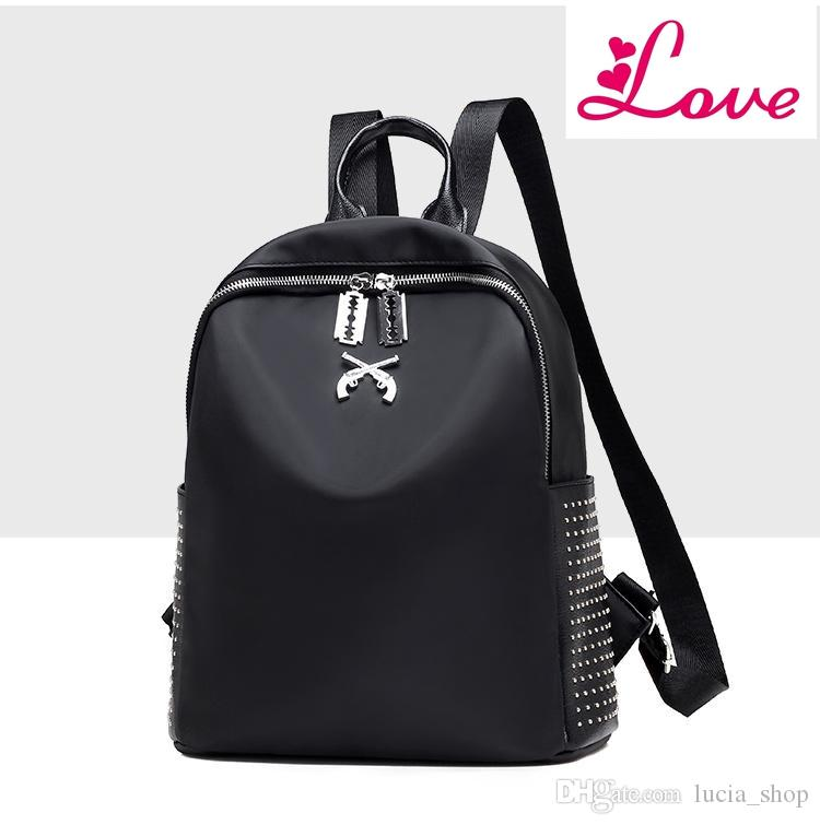 11285157a889 LUCIA S Women Backpacks Famous Brands Nylon Waterproof Rivet Backpack  Pistol Bags Female School Bag For Teenagers Girls Travel Mochilas High  Quality Female ...