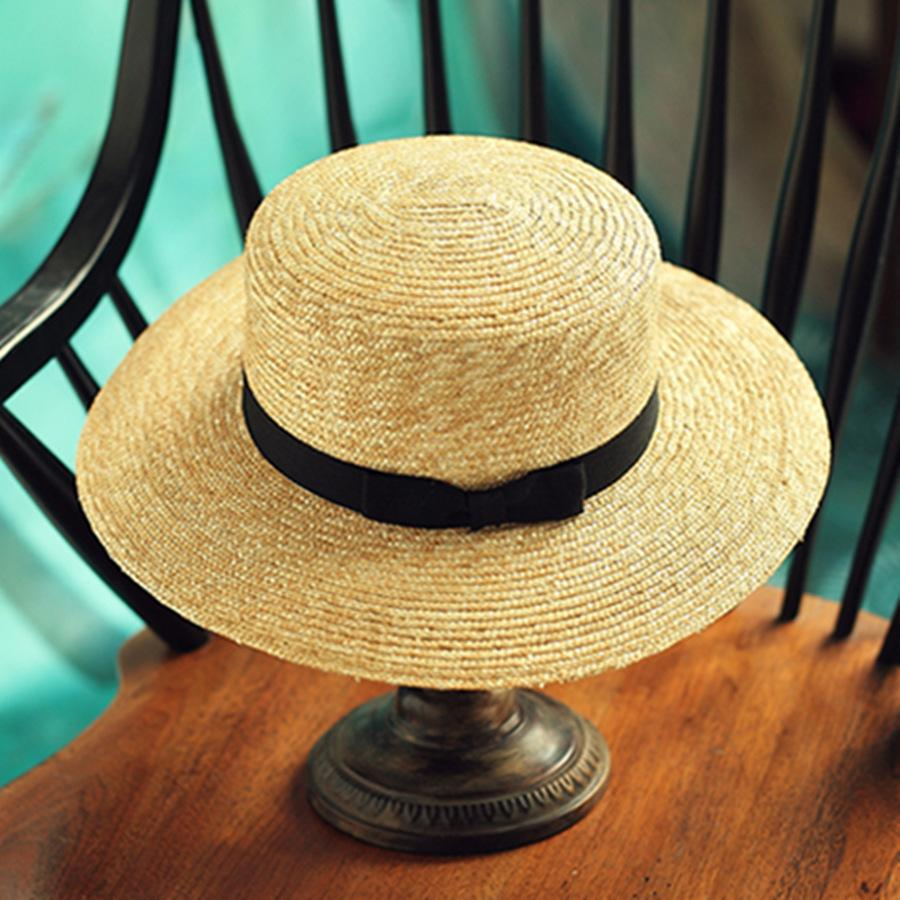 Wholesale Women S Boater Sun Hats 2017 New Fashion Wheat Panama Summer Hats  For Women Boater Chapeau Paille Ladies Straw Hats Accessories Bucket Hat  Fedora ... 6e12f066af7