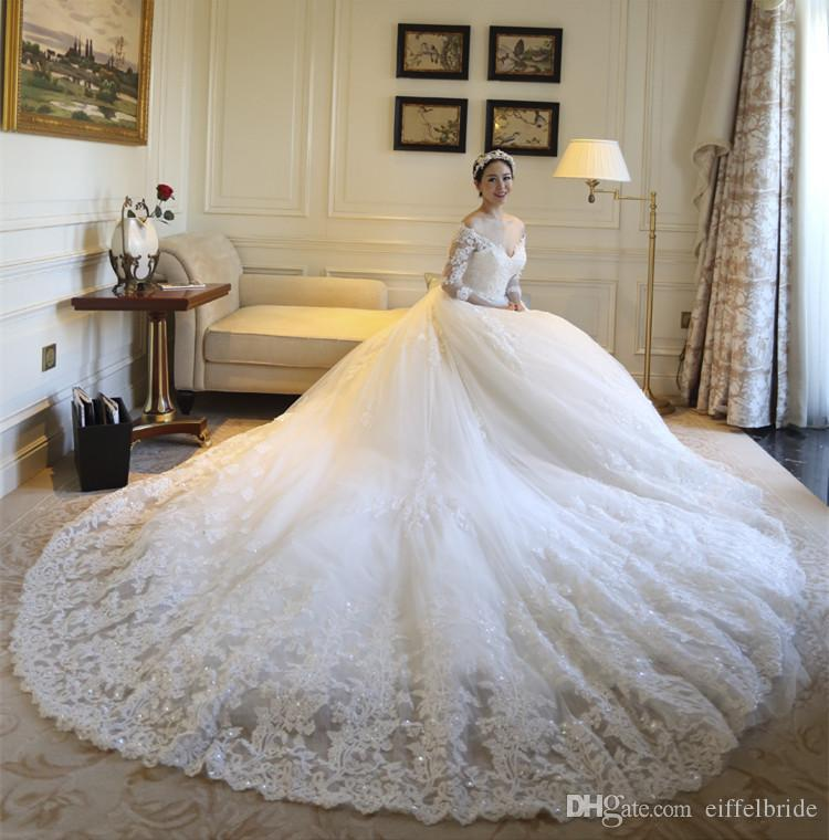 Discount 2016 Modest Wedding Dresses Sexy Bling Beaded Sheer Lace Applique Off Shoulder 3 4 Long Sleeve Ivory A Line Bridal Gowns Cathedral Train
