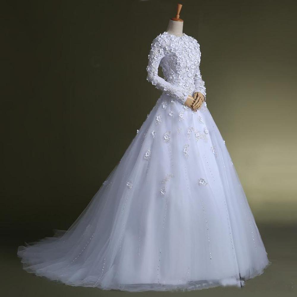 Nuovi abiti da sposa musulmani Manica lunga modesta Gioiello collo Appliques in rilievo Fiori Tulle A Line Abiti da sposa Realizzati su misura