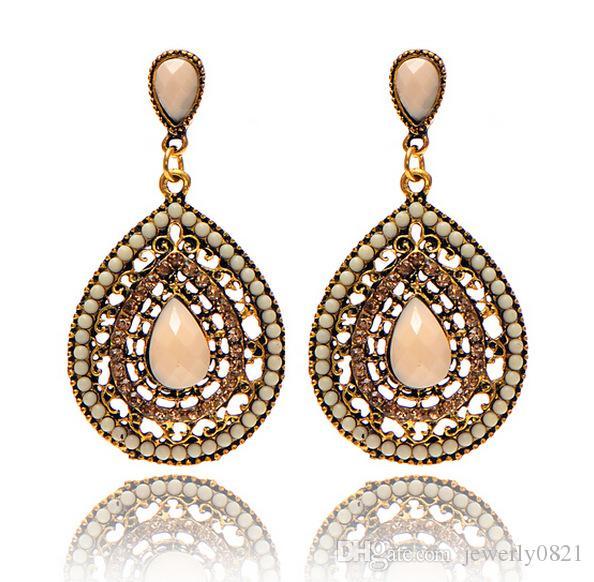 Großhandelsoberseiten-Weinlese-Bronze übertriebene Gold überzogene Ohrringe Böhmen-Nd Ohrringe übertrieben gemischte Art der Frauen, die Eardrop Wedding sind