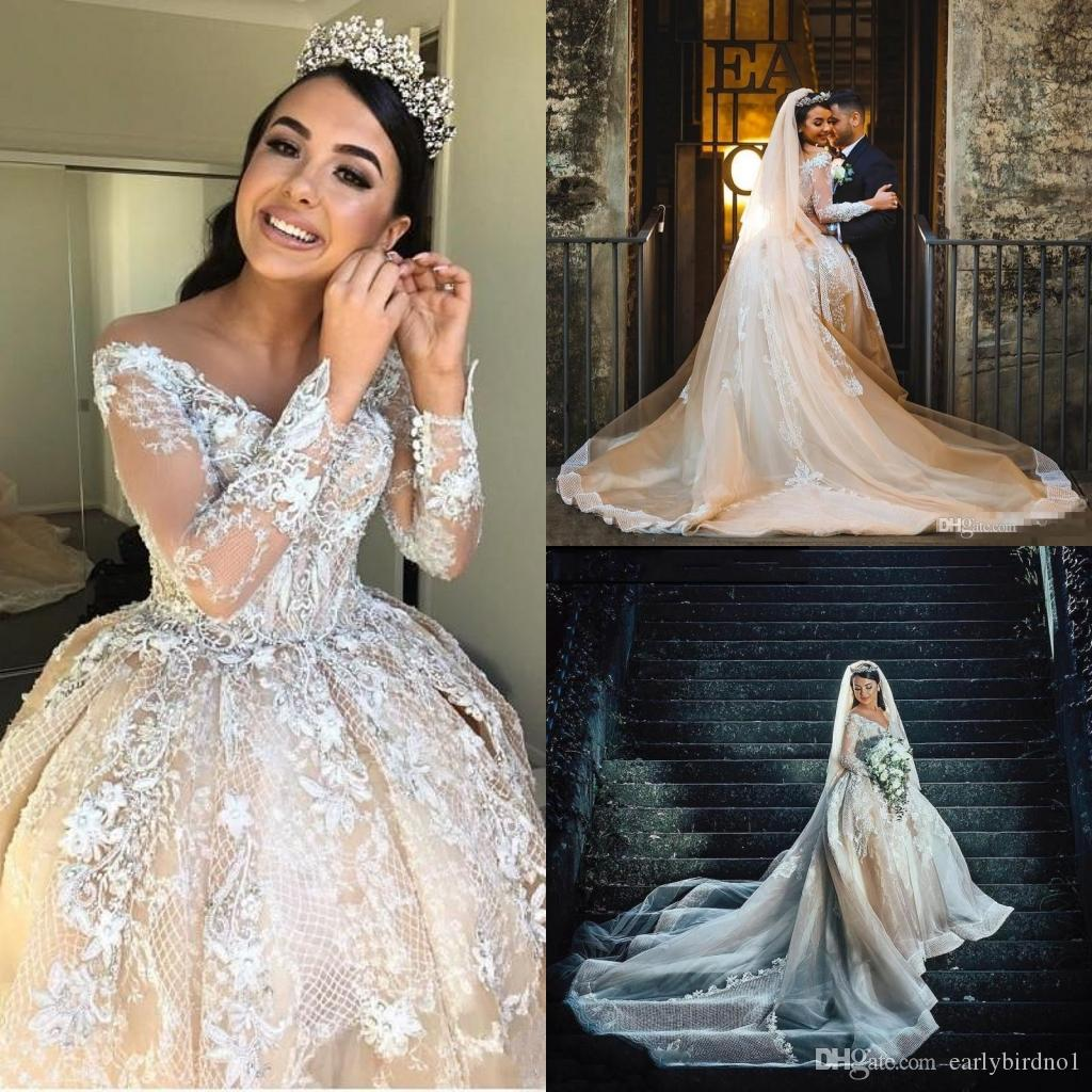 Acquista 2018 Champagne Perline Di Lusso Abiti Da Sposa Arabo Abiti Da Sposa  Sexy Sheer Off The Shoulder Manicotto Da Sposa Abiti Da Sposa Cattedrale  Train ... b7e876a0acb