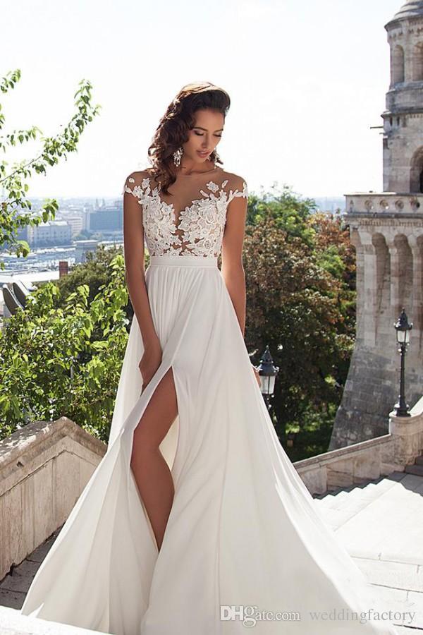 Robes d'été de mariée sexy 2019 Illusion corsage robe de mariée sur la plage Cap Sleeve robes de mariée pays Dentelle Appliques boutons Retour Split