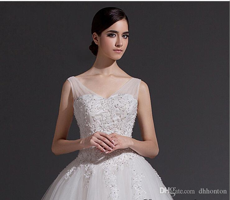 Bridal gown Wedding Dresses Luxury Crystal Bridal Gowns Beads Sheer spaghetti Wedding Dress Crystals Backless Floor Length Tulle BD019