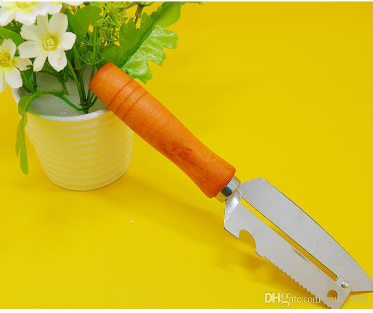Grande poignée en bois de cuisine en acier inoxydable multi-usages avec un éplucheur de fruits éplucheur de fruits Dollar Store