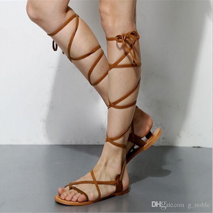 f67884586ea7 Hot Selling Cheap Designer Women S Strappy Sandals Cross Tied Gladiator Flat  Sandals Beach Shoes Jesus Sandals Black Wedges From G noble