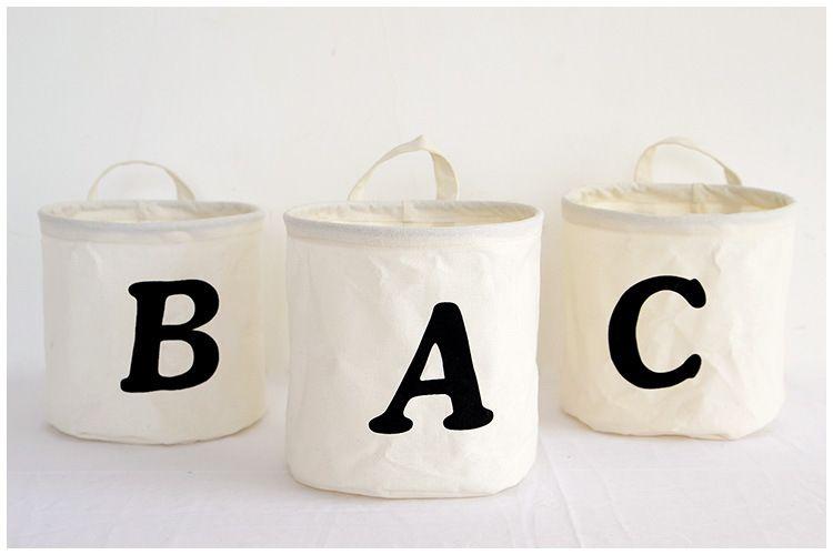 L'arte di stoffa di stile semplice è piccoli cestelli di stoccaggio del secchio con la maniglia Borsa di lerciume rotonda borsa barili di immagazzinaggio del panno della famiglia