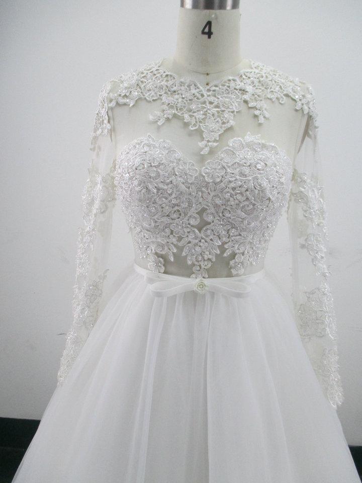 Vestido de novia de tul de encaje con apliques 2018 Vestidos de novia sin respaldo de longitud real Foto