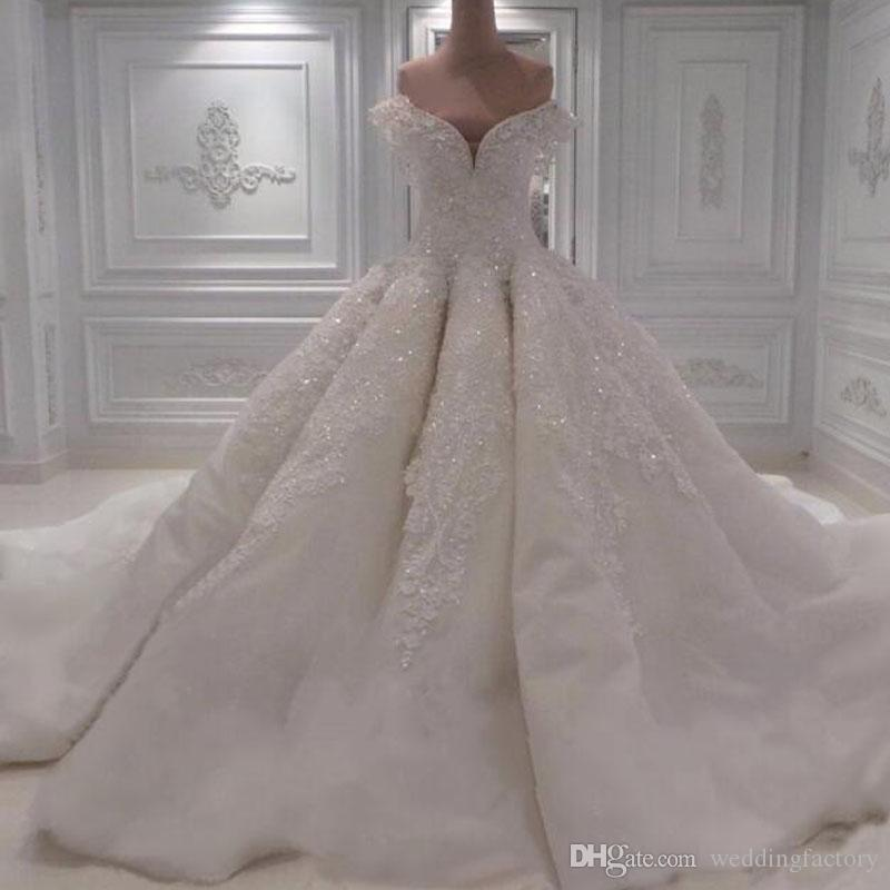 f7e44bcb6ce 2017 Luxury Big Ball Gown Wedding Dresses Off The Shoulder Wave Design  Beaded Crystals Lace Appliques Custom Made Bridal Gowns Long Sleeve Dresses  Plus Size ...