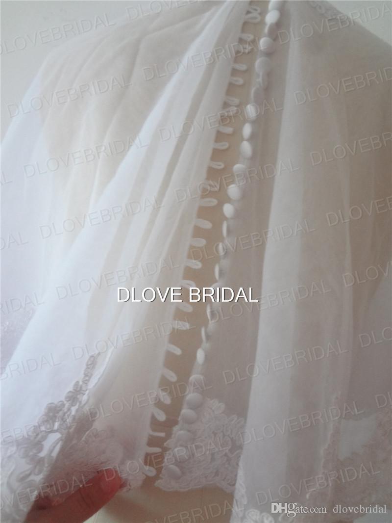 Wrap nuptiale de haute qualité avec dentelle Applique Real Photo blanc ivoire veste de mariage Bolero châle boutons couverts une taille unique