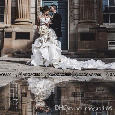 진짜 사진 럭셔리 세부 구슬이있는 주름진 인어 웨딩 드레스 2019 뜨거운 아이보리 연인 백리스 교회 기차 트럼펫 아랍어 웨딩 드레스