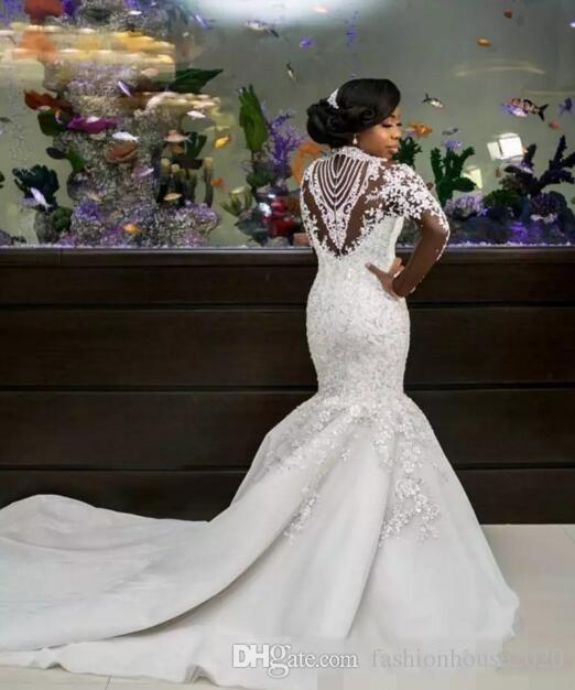 2020 New Luxury African Mermaid Wedding Dresses Long Sleeves High Neck Illusion Lace Appliques Crystal Beaded Long Train Formal Bridal Gowns