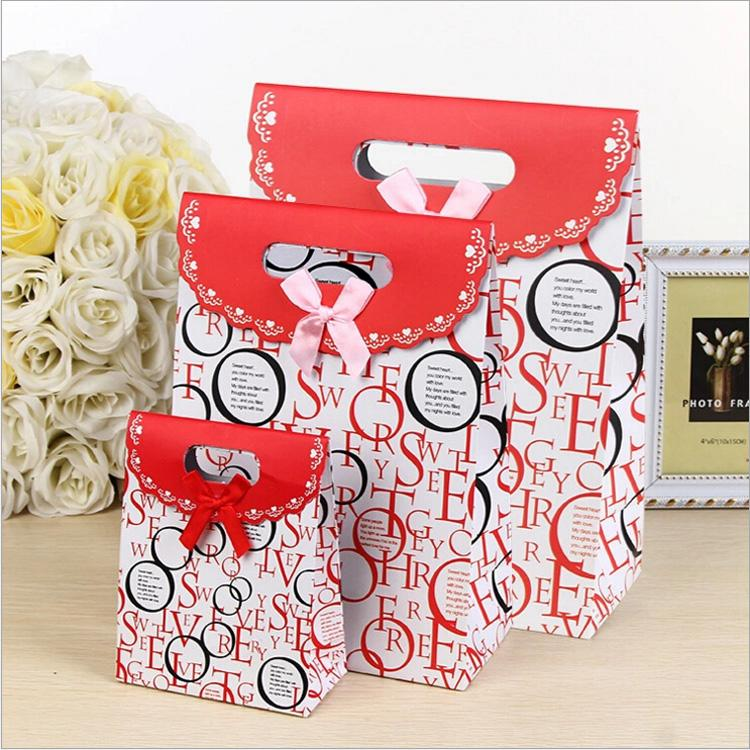 trendy style wedding paper candy bag with bowknot custom printed kids birthday gift bags die-cut handle