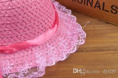 Le nouveau chapeau pour enfants 2016 Straw dentelle soleil chapeau ruban fleur plage chapeaux casquettes en gros cinq couleurs