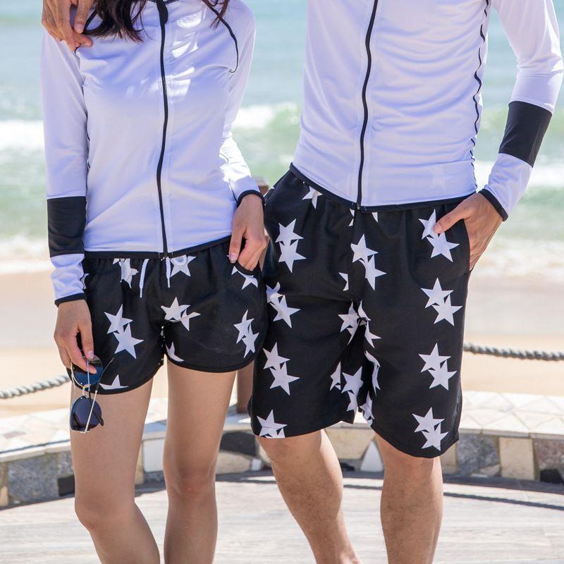 923e62f4a924 2019 Wholesale 2016 Fashion Black White Stars Surf Board Shorts Beach Swim  Pants Lovers Couple Models Men Women Girls Boys Swimwear Shorts A19 From  Huangcen ...