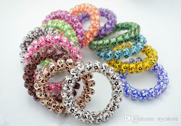 Mischungsfarbe Leopard-große Größen-Haar-Ring-Telefon-Draht-Haar-Gummibänder Bobbles-Haar-Riegel-Bänder Kinderadult-Haar-Zusätze können als Armbänder benutzt werden