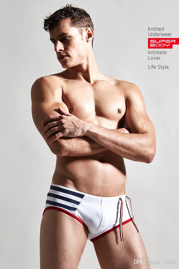 La moda de los hombres con encanto natación desgaste color sexy cintura cintura escritos de natación de la moda de los hombres escritos de natación parque acuático troncos de natación tendencia