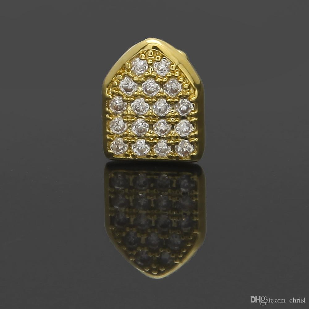 Iced Out Zircon Gold Teeth Grillz Micro Pave Top Bottom Grills Single Tooth  Caps Vampire Tooth Jewelry UK 2019 From Chrisl d8ab9cffb