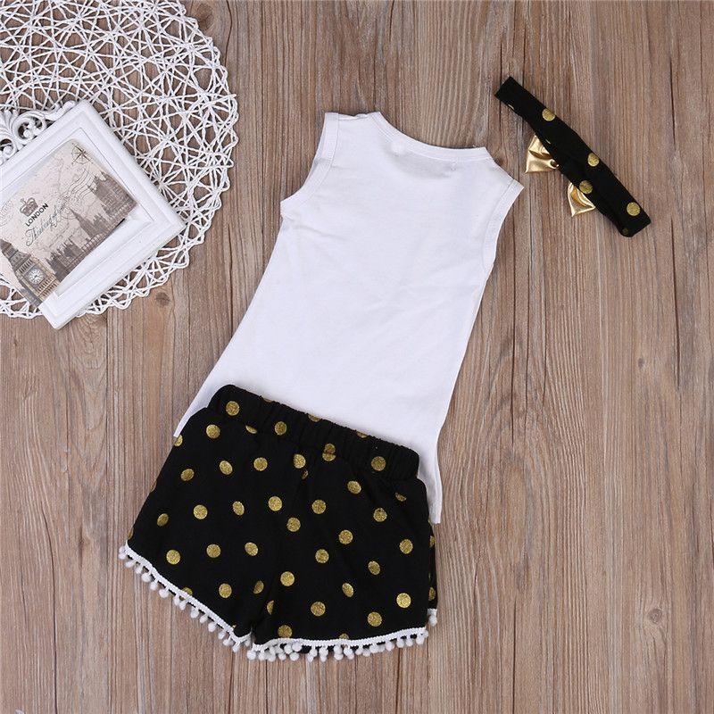 Vestiti delle ragazze Vestiti estivi delle neonate regolano la maglia di stampa della piuma Parti superiori casuali + Pantaloncini della nappa del puntino Fascia d'oro che copre i vestiti di estate