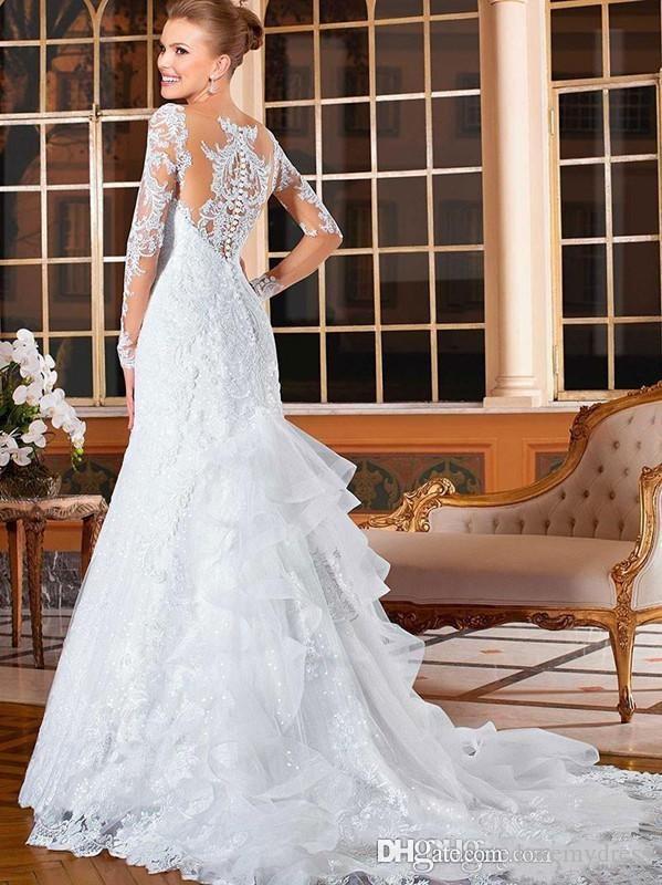 Los últimos vestidos elegantes del cordón Applique de la envoltura de la boda Botón cubierto ocasional Vestidos de boda de manga larga Vestidos de novia del tren de la corte