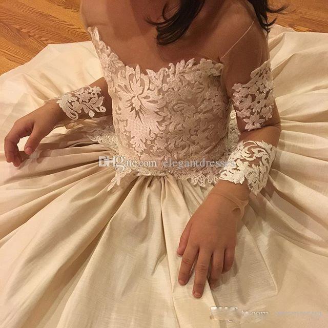レースのアップリケの花の女の子の服の結婚式のシアーネックボウ2021ビーズ長袖フラワーガールドレスベストセラーの誕生日Pageantのドレス