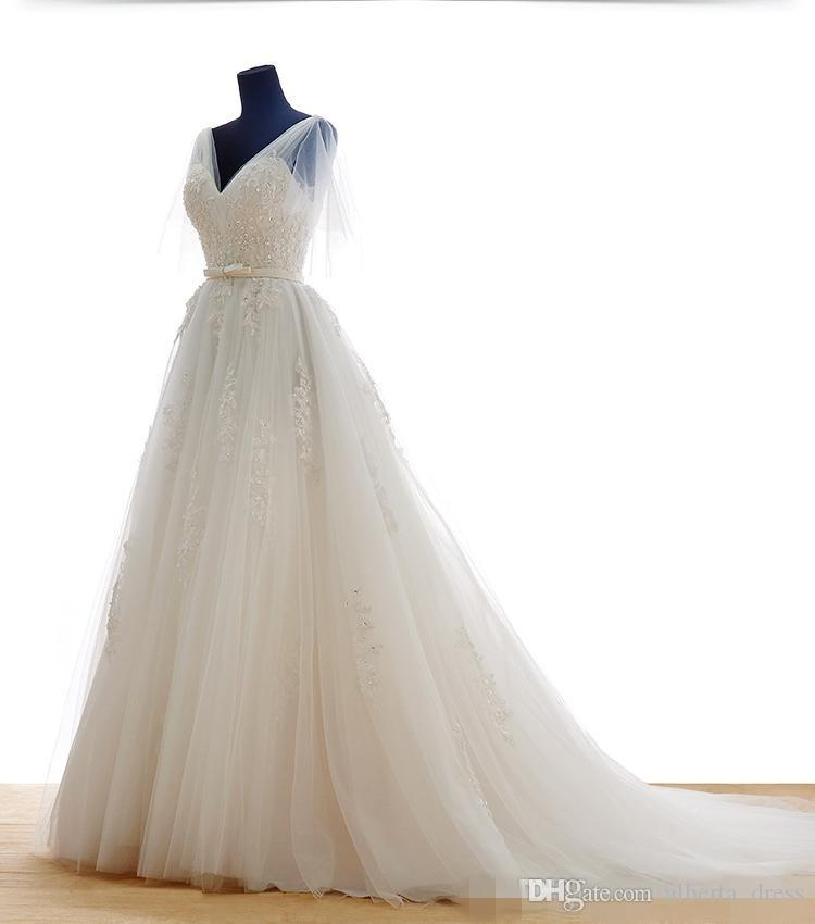 2016 Cheap Ivory Lace Wedding Dresses V Neck Wedding Dress Sheer Backless Wedding Gowns Chapel Train Bridal Gowns