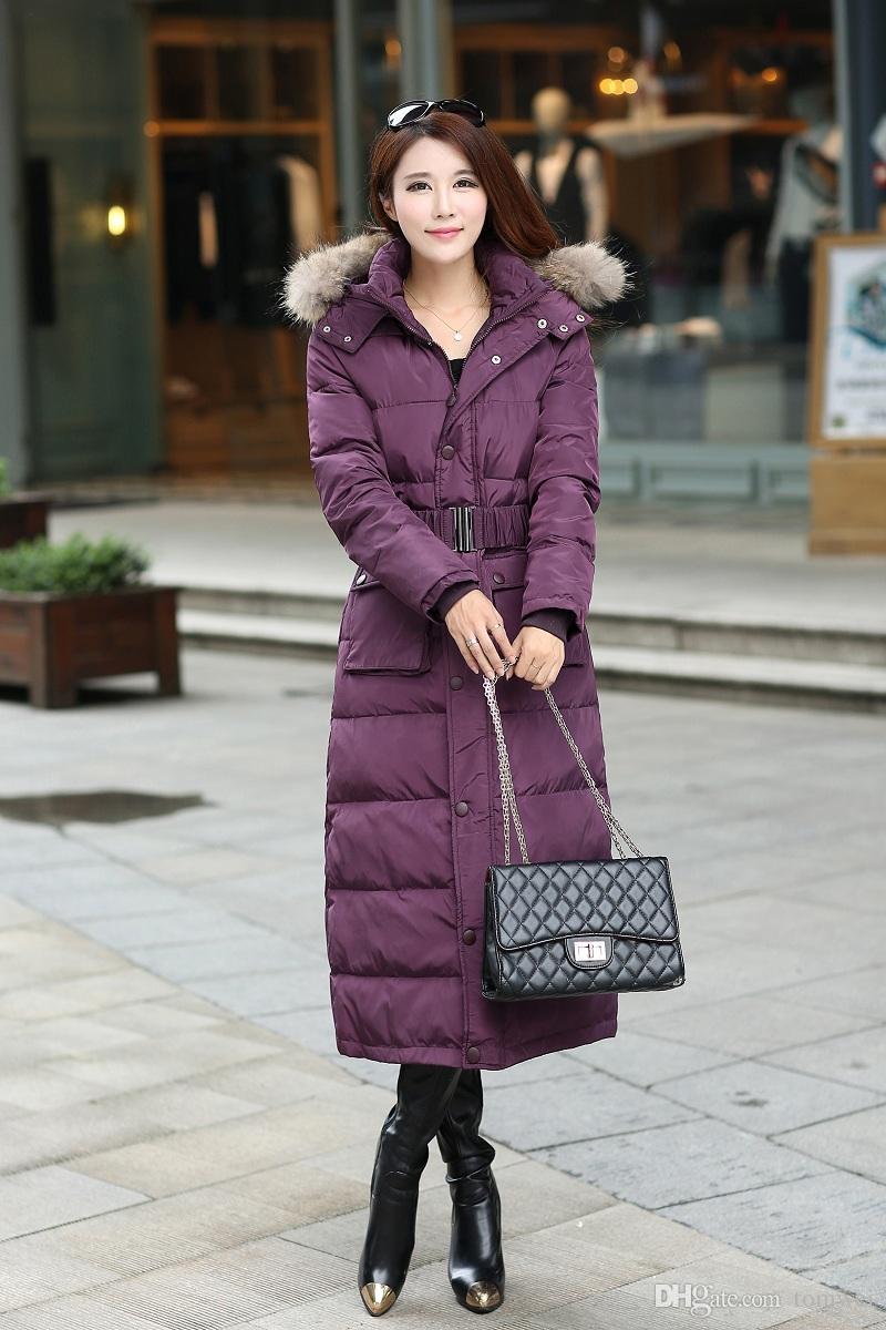 Frauen Daunenjacken lange Mantel natürliche Waschbär Fell Winter Parkas Kapuzen Gürtel Schnee Kleidung dicker warme Outwear Outdoor Jacke S-4XL große Größe