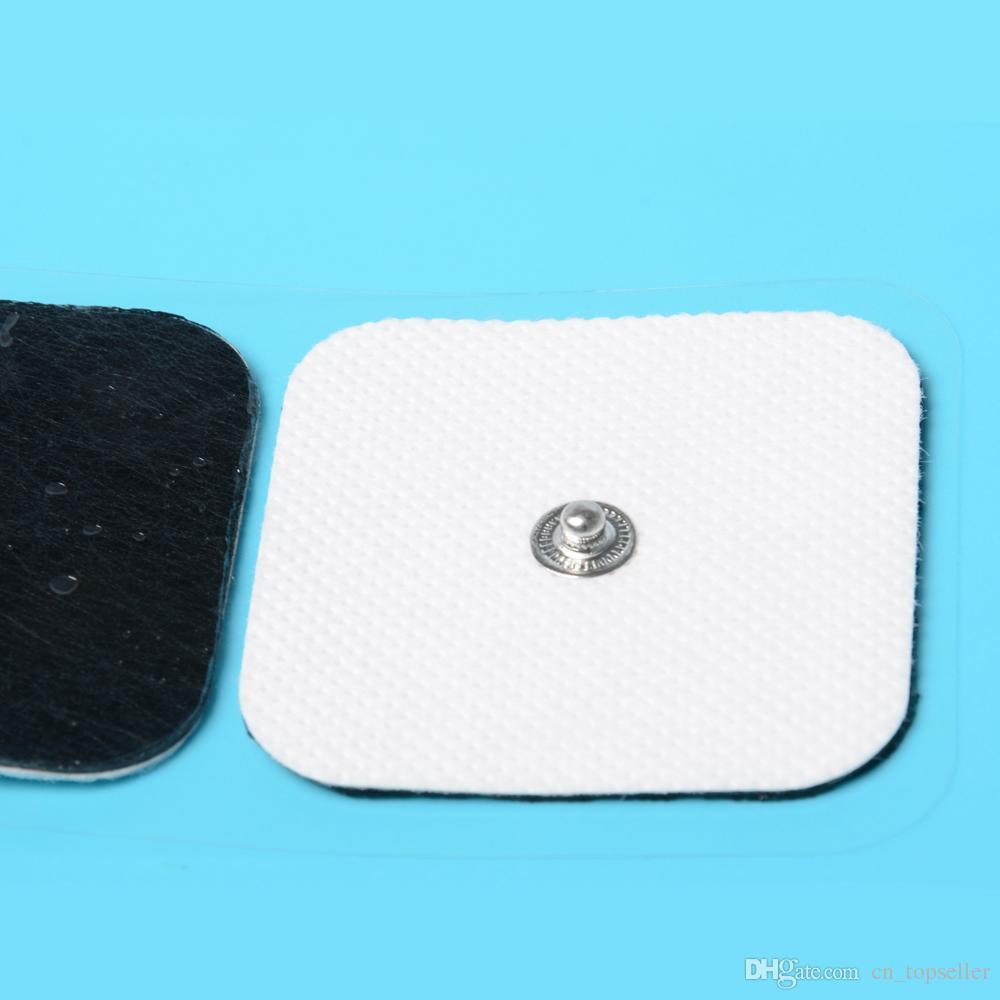 Plaquettes d'électrodes conductrices à utiliser pour les unités TENS / EMS de taille 2 * 2 pouces avec bouton Plaques électro de 3,5 mm