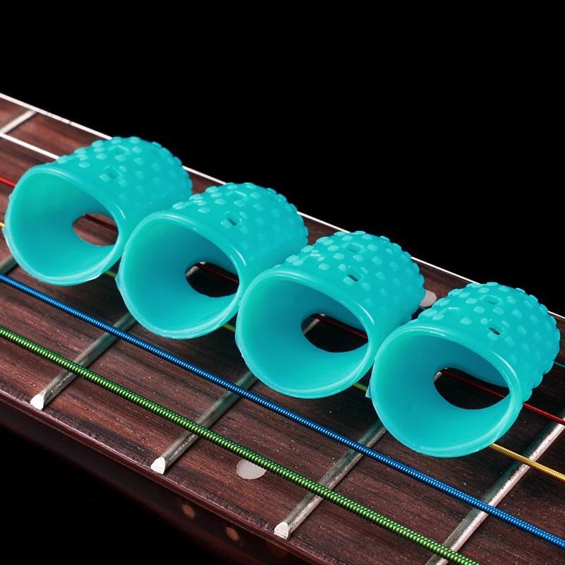 wholesale introductory guitar fingerstall guitar string finger cot protect finger prevent. Black Bedroom Furniture Sets. Home Design Ideas