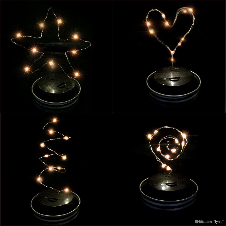Tarros de albañil LED con energía solar Tapa iluminada 10 luces LED de hadas Luces de estrella Tornillo en tapas plateadas para tarros de vidrio de albañil Luces de jardín de Navidad