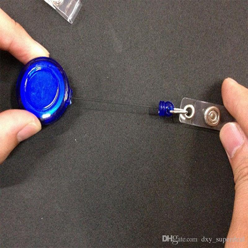 Le porte-badge rétractable de carte d'identification de courroie de lanière roule avec l'agrafe gardent la clé principale de téléphone portable d'identification sûre