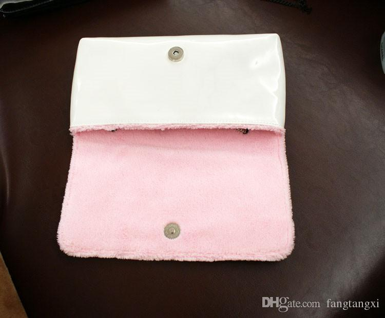 Klassisches muster schwarz / weiß pu mantel von farbe tasche frauen handtasche mit berühmten logo kosmetik make-up paket