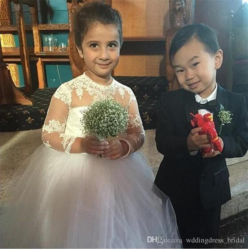 2019 Cute Puffy Mädchen Festzug Kleider für Kleinkinder Long Junior Brautjungfer Kleider Juwel Spitze Applikationen Sheer Long Sleeves Blumenmädchen Kleid