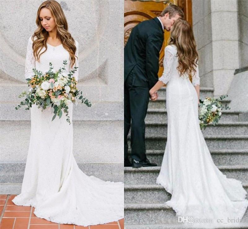Vintage modest beach wedding dresses 2017 with long for Long sleeve wedding dress topper