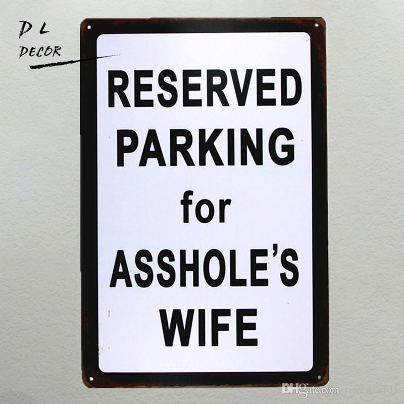 Assholes garage metal sign