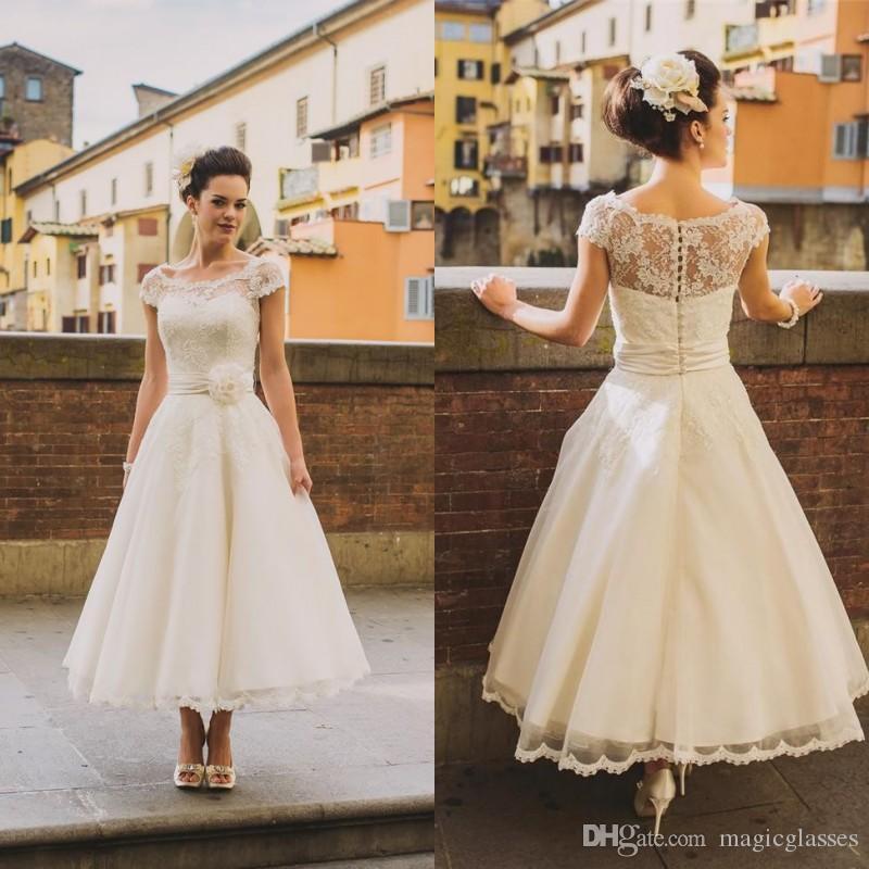 Discount Tea Length Vintage Lace Plus Size Wedding Dresses 2017 A Line  Scoop Cap Sleeves Arabic Country Rustic Wedding Gowns Bridal Dresses Flowers  Designer ... db10bb1bb755