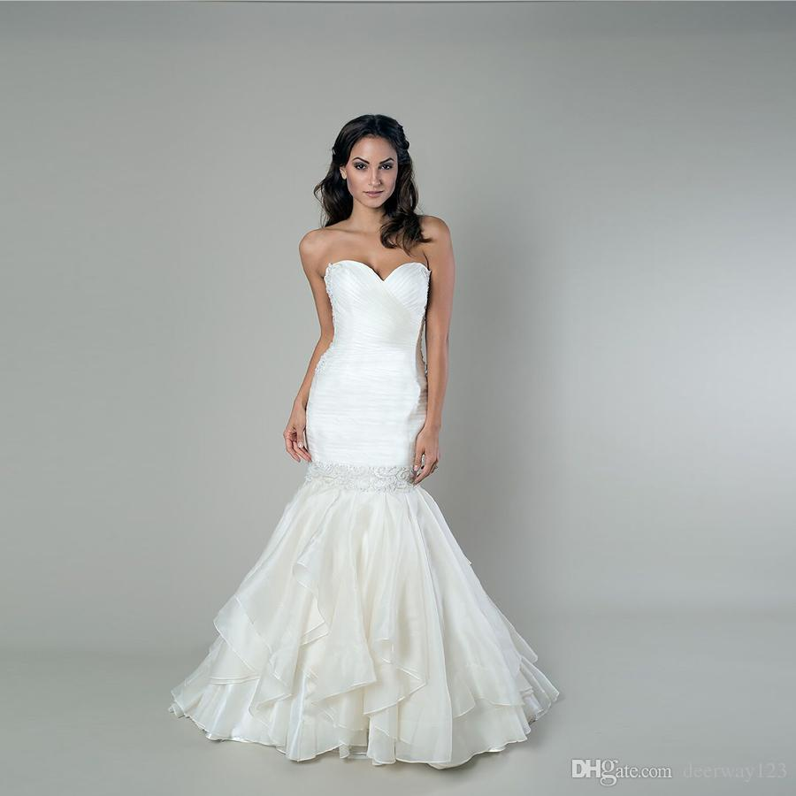 Exaggerated Mermaid Wedding Gown Features A Ruched Wrapped Bodice ...