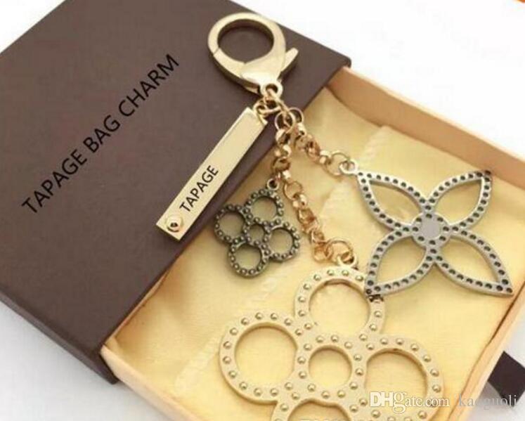 Porte-clés Charm fleurs porte-clés en cuir Mahina perforé SAC TAPAGE CHARM Sac M65090 livré avec dustbag Box