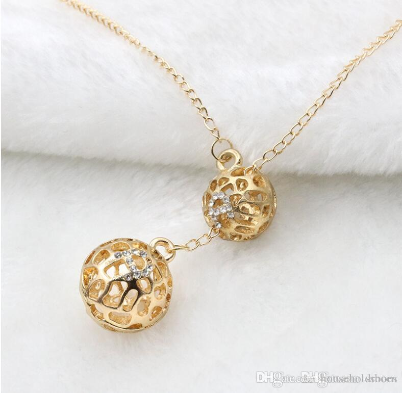 Wholesale fashion women gift round hollow flower ball pendant wholesale fashion women gift round hollow flower ball pendant crystal rhinestone pendant necklaces silver plated long chain jewelry accessories rose gold aloadofball Images