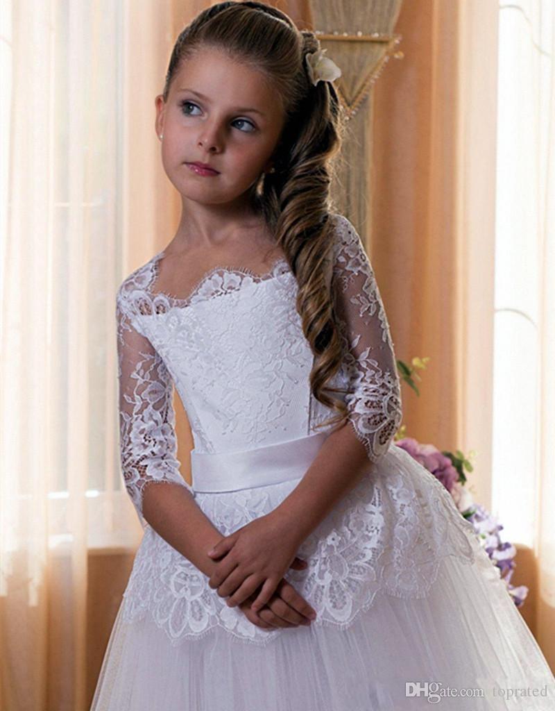 Reizende Illusions-halbe Hülsen-Spitze-Blumen-Mädchen-Kleiderballkleid mit der Schärpe geschwollene Tulle-Röcke nach Maß heiliges Erstkommunion-Party-Kleid