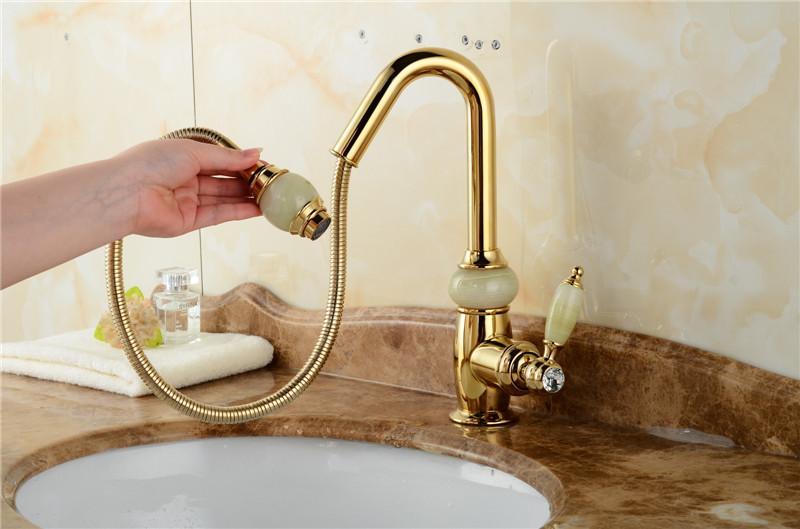 Luxury golden Pull Down Bathroom Sink Faucets Wholesale New Arrival Solid Brass Swivel Pull Out Spray Gooseneck Sink Mixer Tap